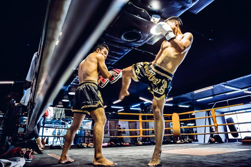 Muay Thai athletes training on the boxing ring